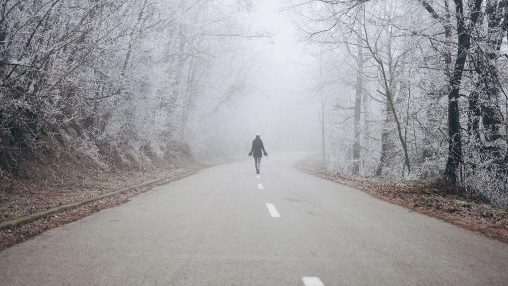 Walking alone under the harsh sun